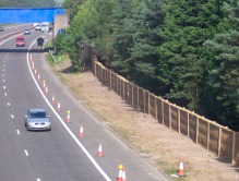 Acoustic Green Barrier in woven willow absorbing noise from dual carriageway
